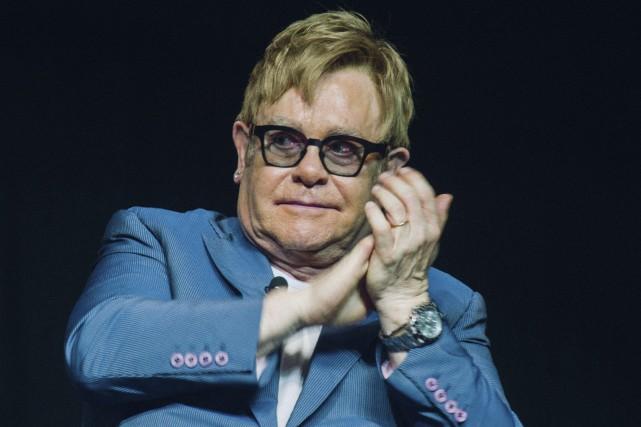 Elton John, Sharon Stone et Benicio Del Toro... (AFP, Matthew Kay)