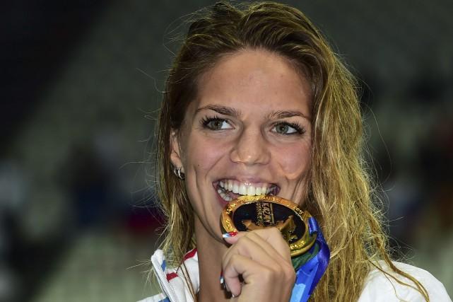 La championne du monde en titre du 100... (Archives AFP, Christophe Simon)