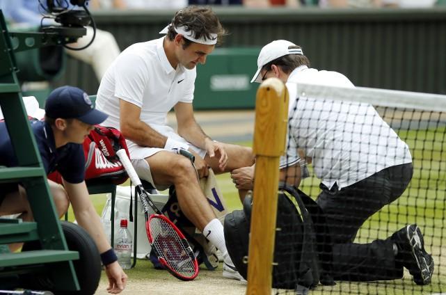 Roger Federer est le premier membre du célèbre... (AP, Alastair Grant)