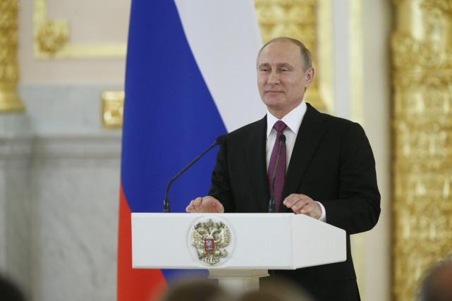 Le président Vladimir Poutine au Kremlin... (AP, Alexander Zemlianichenko)
