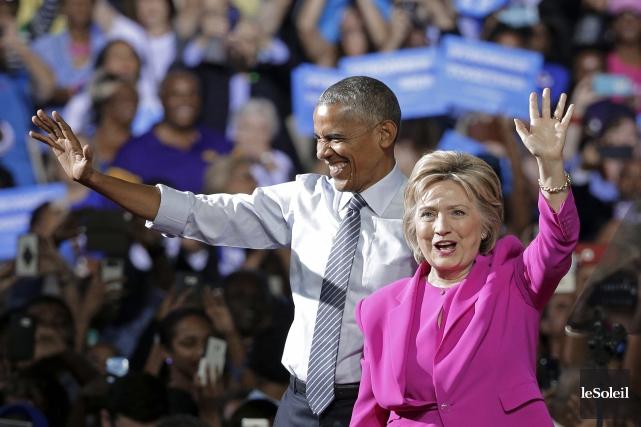 Le président Barack Obama et la candidate Hillary... (Photothèque Le Soleil, AP, Chuck Burton)