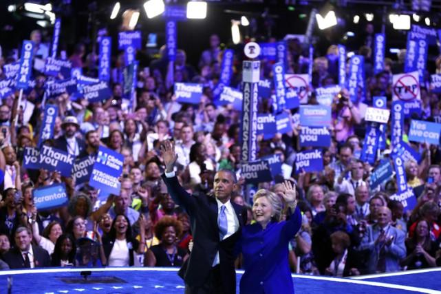 À la fin du discours du président, Hillary... (PHOTO AP)