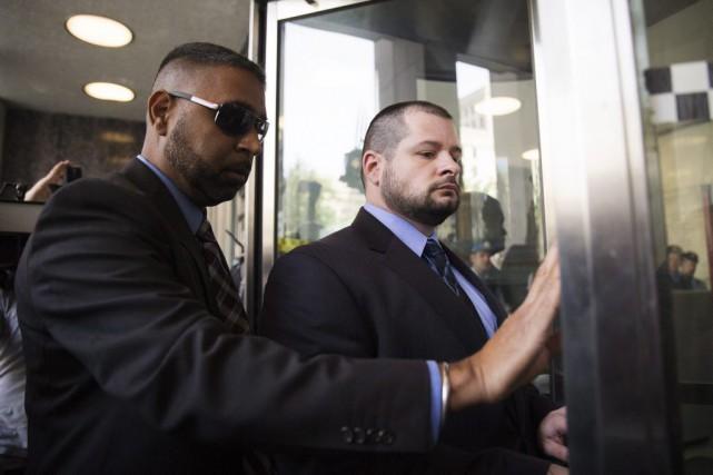 Le policier James Forcillo, lors de son arrivée... (Michelle Siu, PC)