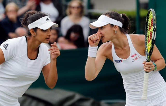 Sania Mirza et Martina Hingis ont déjà gagné... (photo Ben Curtis, archives associated press)