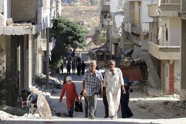 «Des dizaines de familles sont sorties le matin... (AFP)