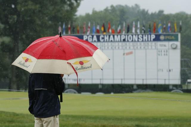 La pluie a forcé l'interruption du Championnat de... (AP, Tony Gutierrez)