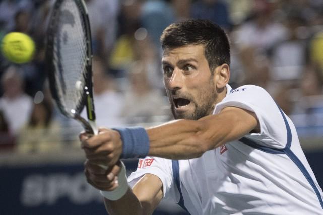Novak Djokovica dominé Gaël Monfils en deux sets... (AFP, Kevin Van Paassen)