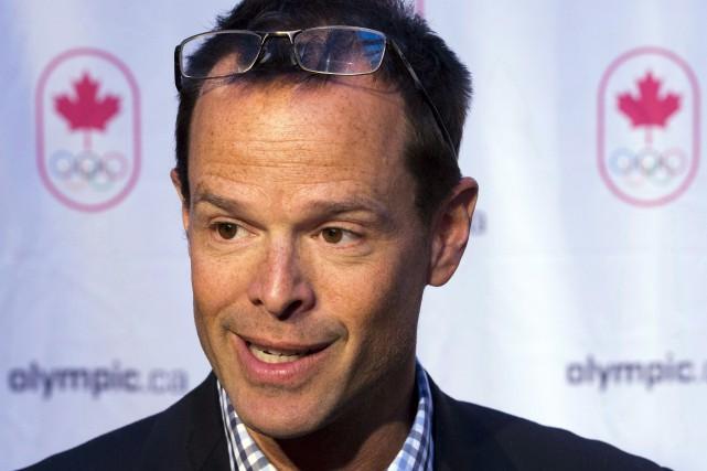 Jean-Luc Brassard ditne pas regretter d'avoir quitté ses... (Archives La Presse Canadienne, Ryan Remiorz)