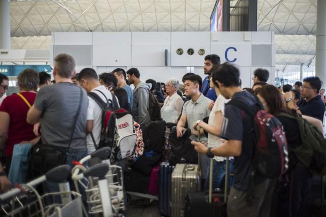 Plus de 150 vols avaient été annulés lundi... (PHOTO ANTHONY WALLACE, AGENCE FRANCE-PRESSE)