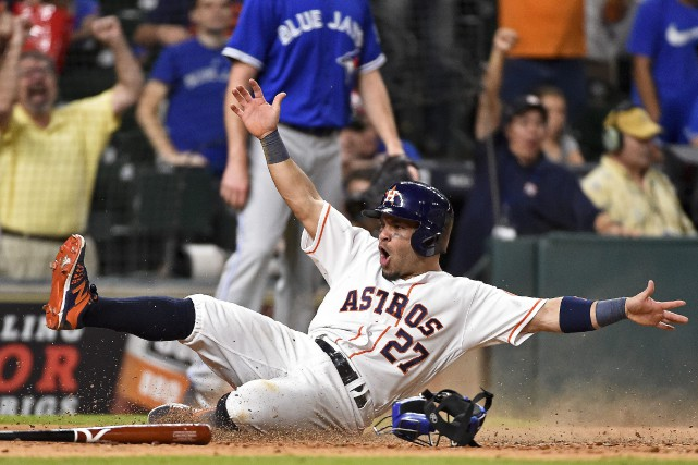 Jose Altuve a marqué le point gagnant pour... (Photo Eric Christian Smith, AP)