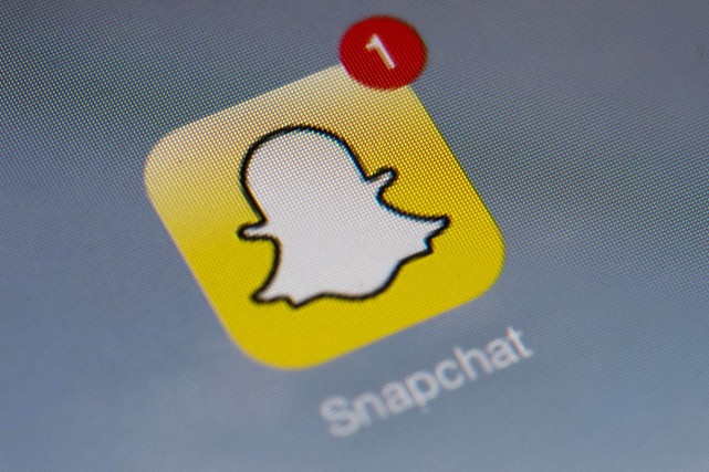 Le logo de l'application Snapchat... (Photo Lionel BOnaventure, AFP)