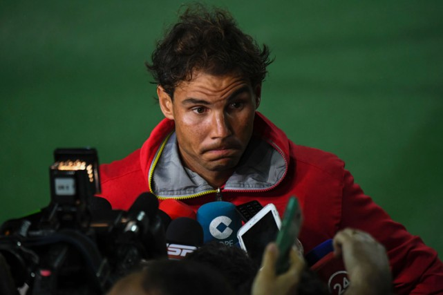 Rafael Nadalsera le porte-drapeau de la délégation espagnole... (PHOTO AFP)