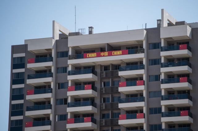 Les résidences de l'équipe chinoise au Village olympique... (Photo Ed Jones, AFP)
