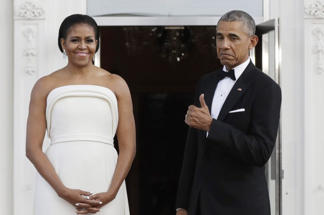 Michelle et Barack Obama s'amusent en attendant le... (photo Manuel Balce Ceneta, archives AP)