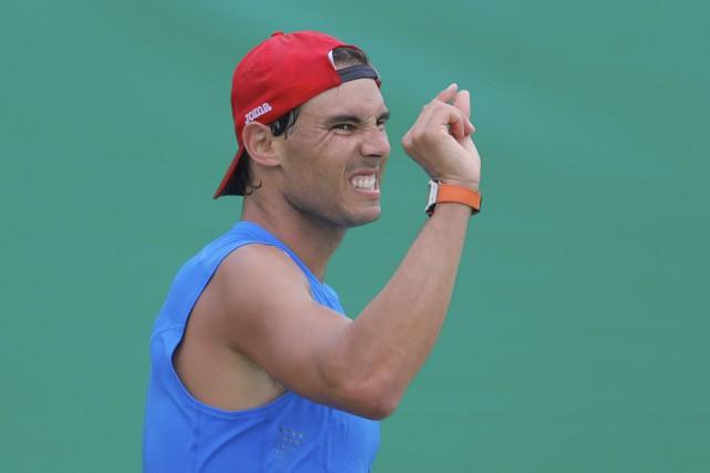 Rafael Nadal portera le drapeau de l'Espagne.... (AP, Vadim Ghirda)