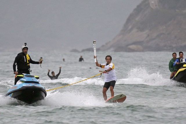 La flamme olympique a parcouru une certaine distancesur... (AP, Charlie Riedel)