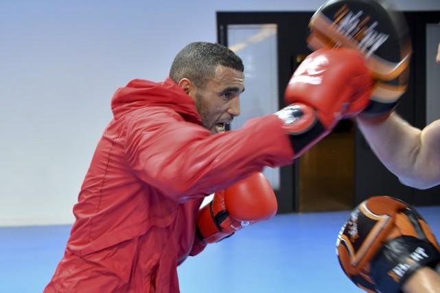 Le boxeur marocain Hassan Saada... (Photo YURI CORTEZ, AFP)