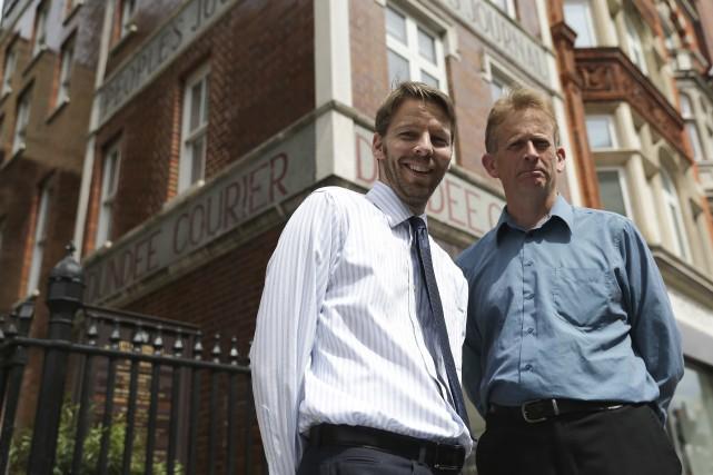 Darryl Smith etGavin Sherriff, les deux derniers journalistes... (AFP, Daniel Leal-Olivas)
