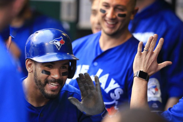 Devon Travis a amorcé la rencontre avec une... (Associated Press)