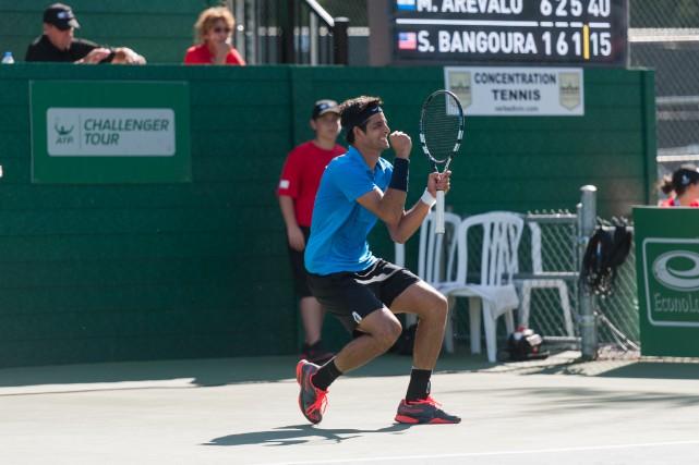 Le Salvadorien Marcelo Arevalo célèbre après avoir remporté... (photo Sarah-Jäde Champagne)