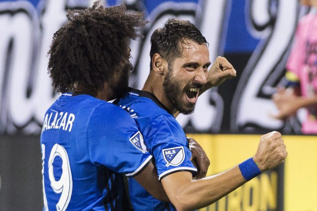 Montreal Impact's Matteo Mancosu, right, celebrates with teammate... (PHOTO GRAHAM HUGHES, PC)