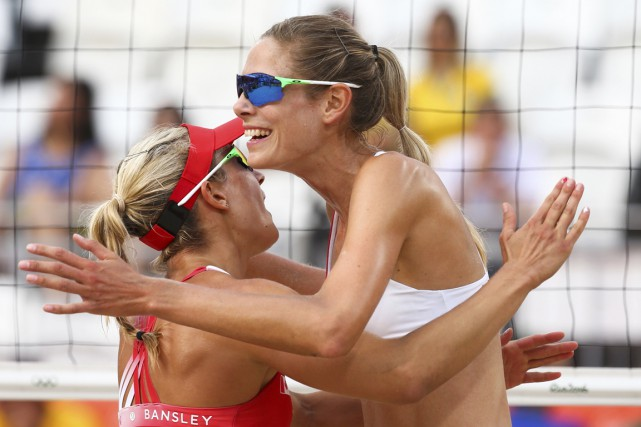 Heather Bansley et Sarah Pavan... (PHOTO RUBEN SPRICH, REUTERS)