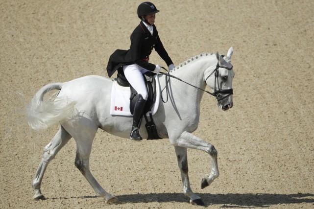 À ses débuts aux Jeux olympiques, la cavalière... (AP)