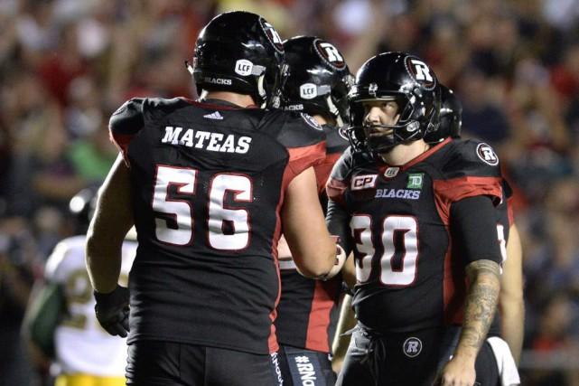 Le Rouge et Noir a gagné 23-20 grâce... (Justin Tang, La Presse Canadienne)