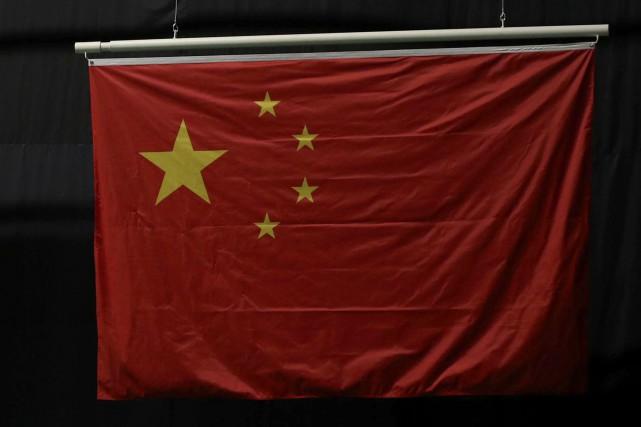 Les quatre petites étoiles des drapeaux chinois aux... (Photo Geoff Burke, USA Today Sports)