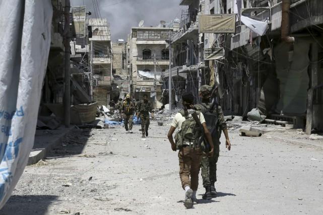 Le monde continue de fermer les yeux sur... (AFP, Delil Souleiman)