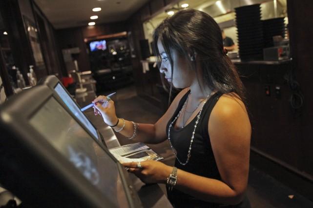 Des produits informatiques utilisés pour traiter des réservations et des... (Bloomberg)