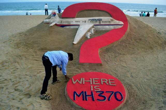 Le vol MH370 de Malaysia Airlines disparu il y a plus de deux ans a plongé dans... (PHOTO J.K. JAGDEV, ARCHIVES AGENCE FRANCE-PRESSE)