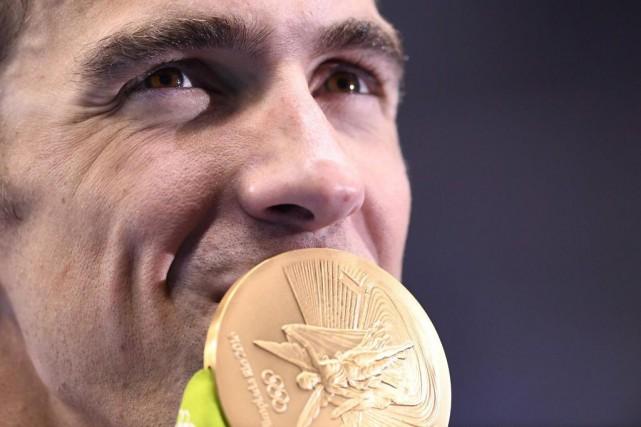 Michael Phelps, l'homme le plus titré de l'histoire... (PHOTO GABRIEL BOUYS, AGENCE FRANCE-PRESSE)