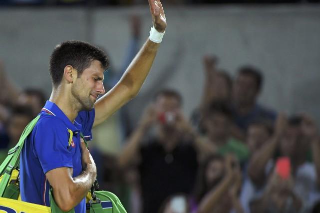 Novak Djokovic a été éliminé par Juan Martin... (Photo Tony Melville, REUTERS)