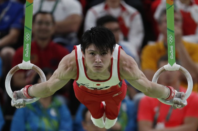 Le gymnaste japonais Kohei Uchimura aux anneaux.... (Photo Thomas Coex, AFP)