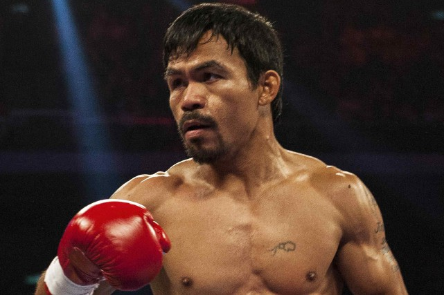 Manny Pacquiaova retourner sur le ring le 5... (AFP, Xaume Olleros)