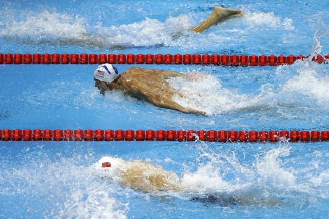 Michael Phelps, jeudi, lors du 200 mètres quatre... (Photo Matt Slocum, AP)
