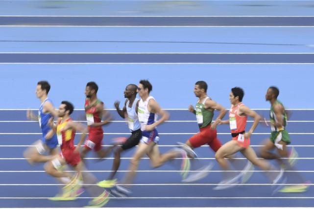 Les compétitions d'athlétisme ont débuté vendredi matin dans... (AFP, Fabrice Coffrini)