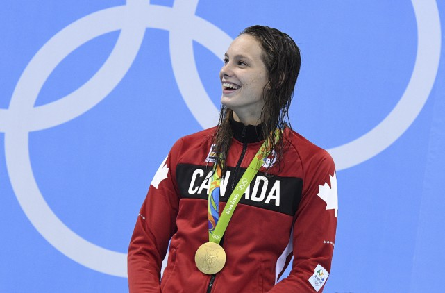 À 16 ans et déjà quadruple médaillée olympique,... (La Presse canadienne, Sean Kilpatrick)