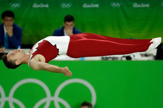 Jason Burnett a pris le 14e rang lors des qualifications.... (PHOTO DMITRI LOVETSKY, AP)