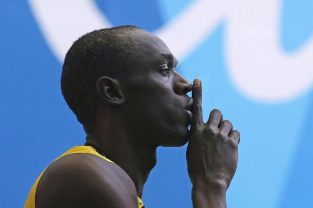 Usain Bolt a imposé le silence à la... (AP, Jae C. Hong)