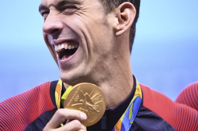 Michael Phelps a remporté 23 médailles d'or olympiques... (AFP, Gabriel Bouys)