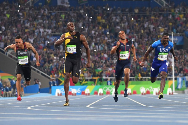 Bolt a signé un chrono de 9,81 secondes,... (PHOTO AFP)