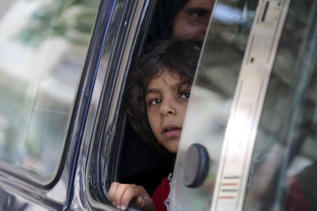 Fatima était heureuse de rentrer chez elle à Minbej, libérée des djihadistes,... (PHOTO DELIL SOULEIMAN, AGENCE FRANCE-PRESSE)