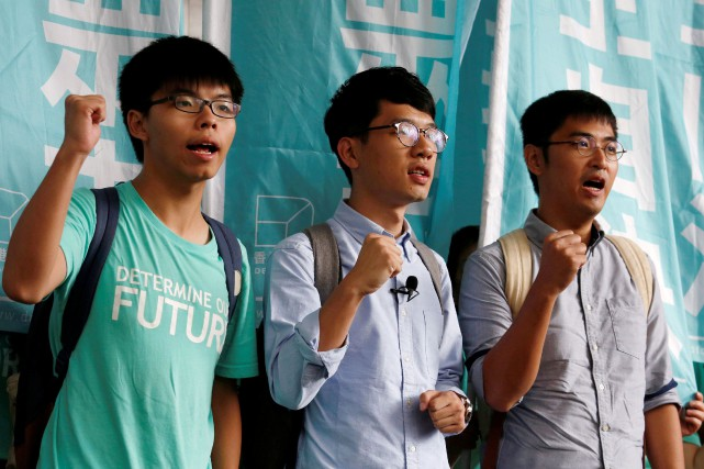 Joshua Wong, Nathan Law et Alex Chow.... (PHOTO BOBBY YIP, REUTERS)
