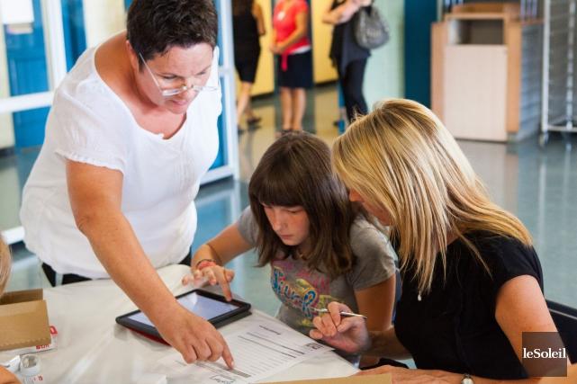 Acheter, louer ou emprunter un iPad sur les... (Photothèque Le Soleil, Caroline Grégoire)