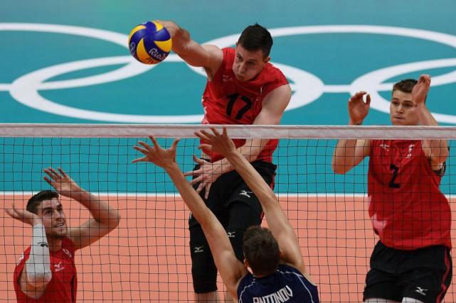 En battant l'équipe nationale italienne de volleyball, le... (Photo VANDERLEI ALMEIDA, Agence France-Presse)