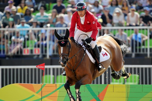Le cavalier canadien Éric Lamaze... (Photo Tony Gentile, REUTERS)