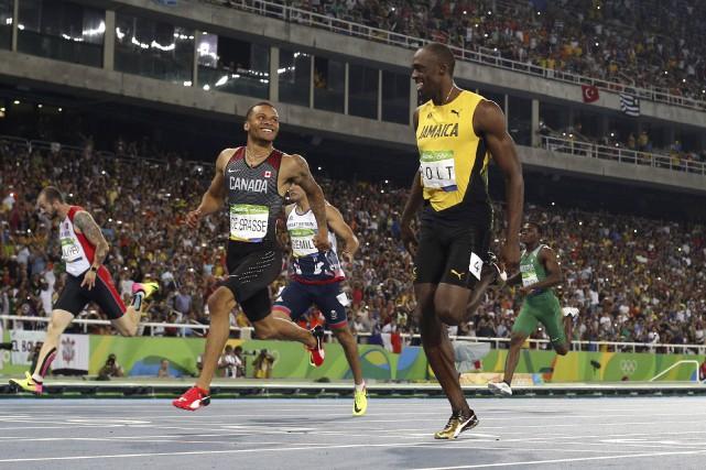 Andre De Grasse et Usain Bolt se sont... (AFP, Adrian Dennis)