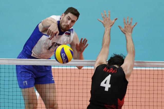 Maxim Mikhaylov et la Russie ont éliminé Nicholas... (AP, Robert F. Bukaty)